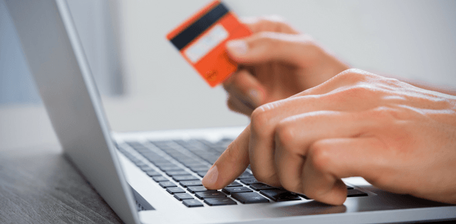 Person paying bill online with credit card