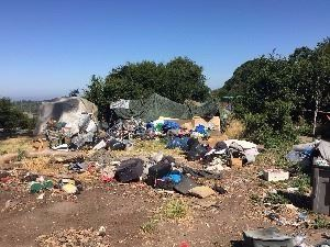 homeless encampment garbage and other debris