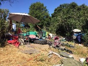 homeless encampment garbage and household items
