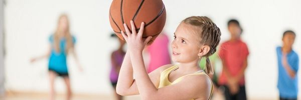 Girl shooting basketball
