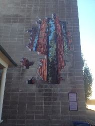 Painted redwood trees mural on side of a building