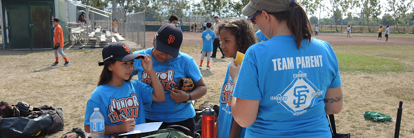 Junior Giants Volunteer helping out players