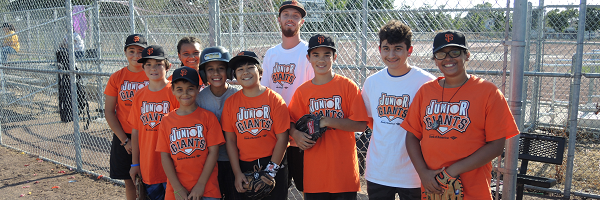 Junior Giants Volunteer with team
