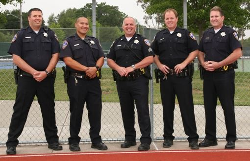 School Resource Team officers standing in front of school yard