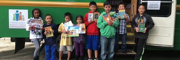 Kids Holding Books from Book Mobile