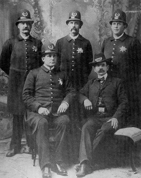 Black and white photograph of Charles H. Holmes, Jr. with other police officers