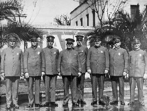 George W. Matthews standing with other police officers