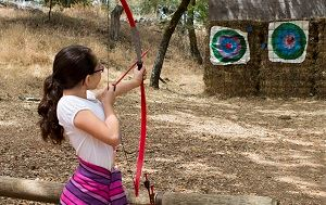 Girl Shooting Bow and Arrow