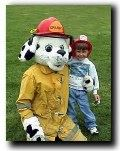 Child with someone in a Sparky the Dalmatian costume.
