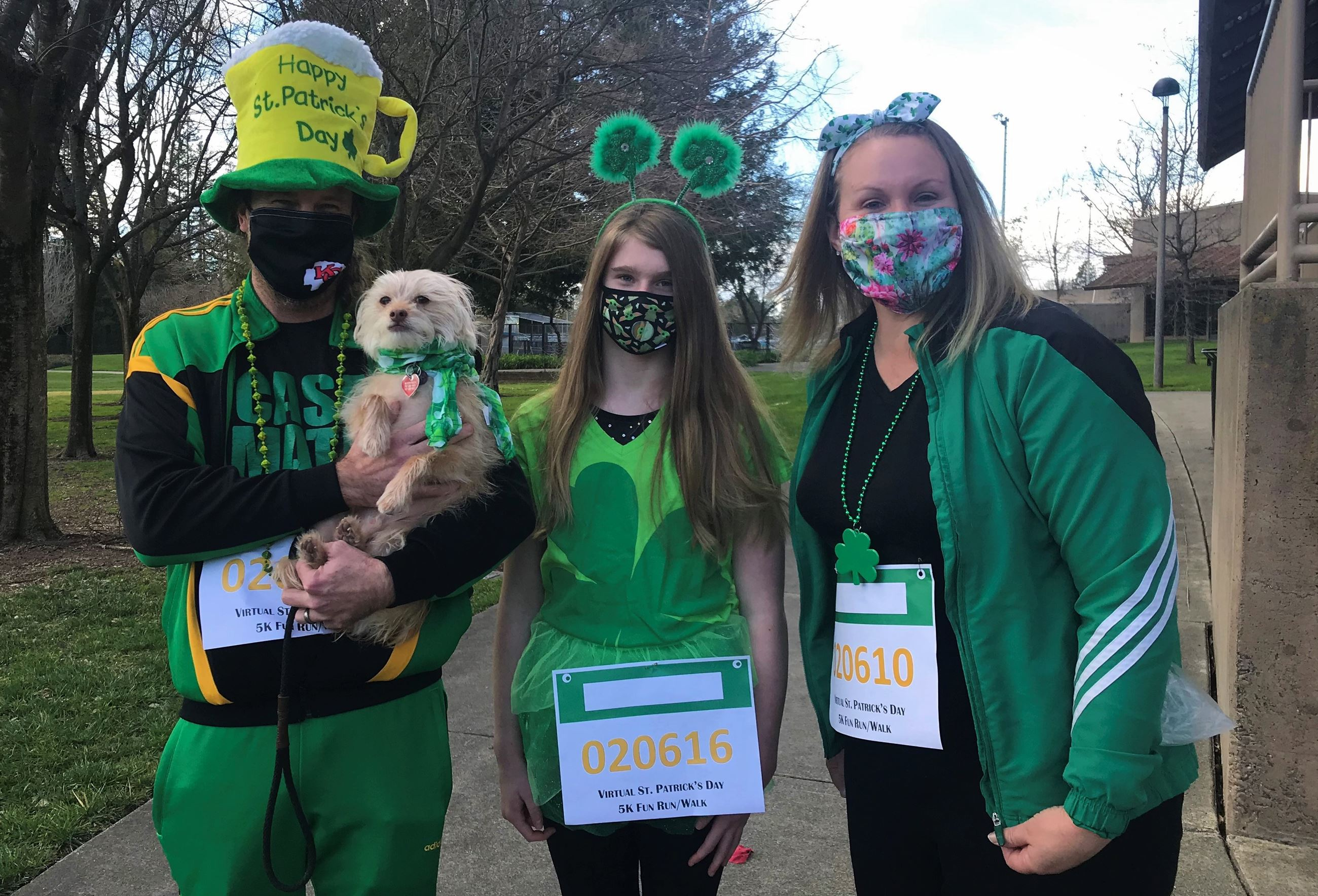 Family and dog dressed up in St. Patrick's gear