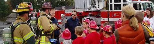 Firefighters teaching kids about safety.