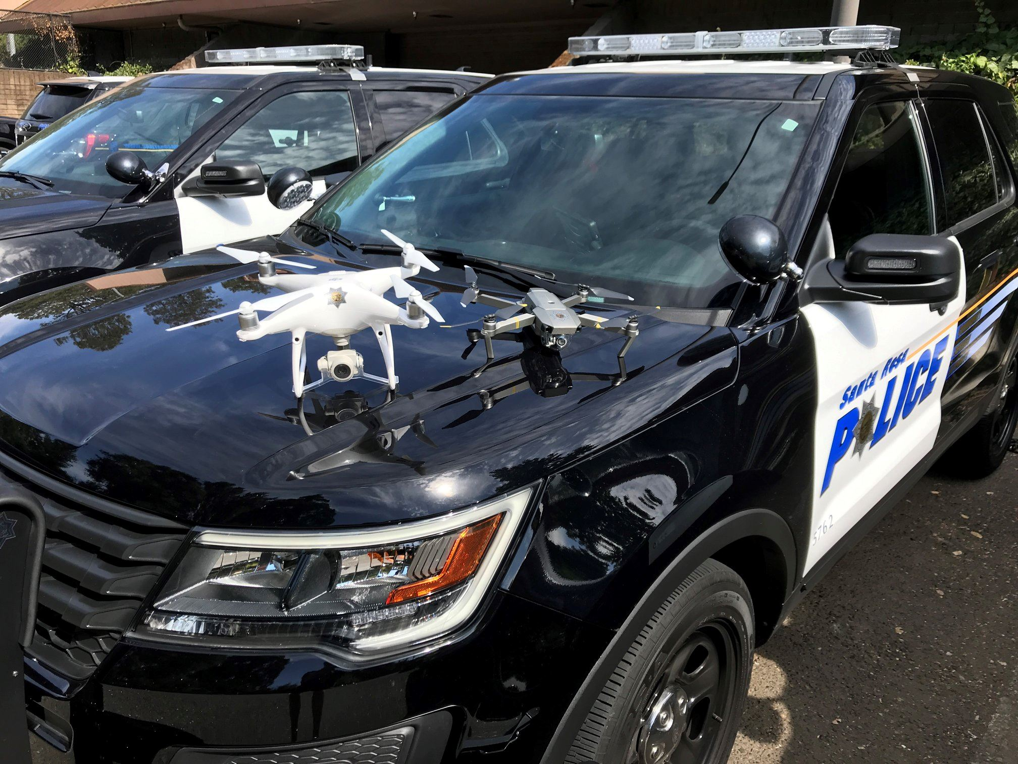 Photo of drones on patrol vehicle hood