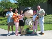 Group of people by a Charlie Brown statue